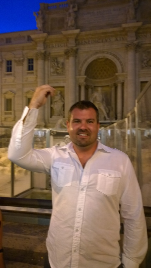 Throwing a coin in the make-shift Trevi Fountain, while the real one was under construction